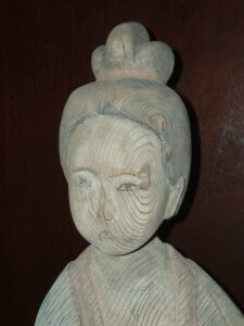 Carved and painted figure of a female court attendant, Han to Tang dynasty.