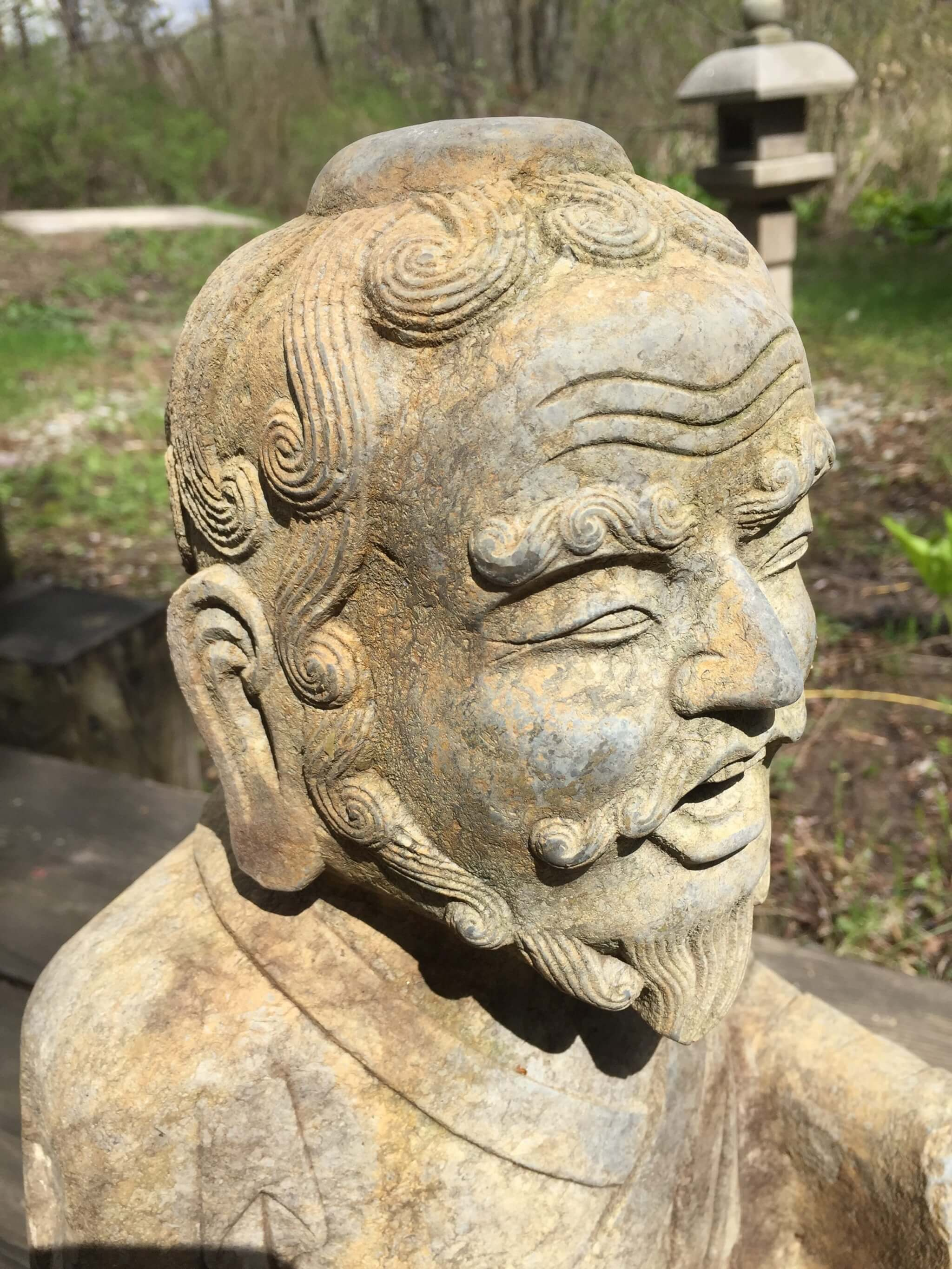 Large antique stone buddhist bearded hand carved figure