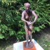 Bronze nude holding dove